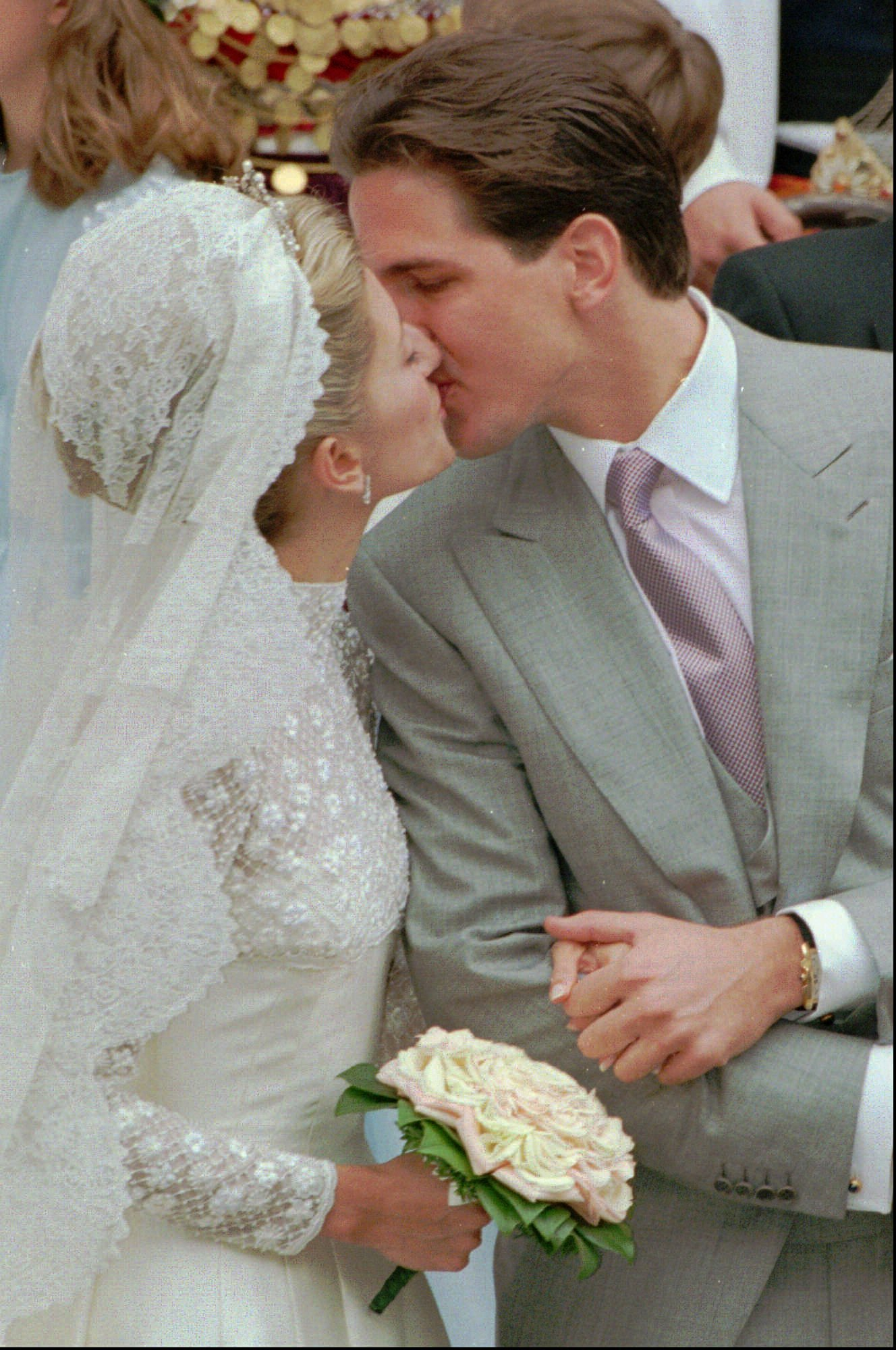 Crown Prince Pavlos of Greece kisses his new bride Marie-Chantal following their wedding at the Greek Cathedral in London, Saturday, July 1, 1995.